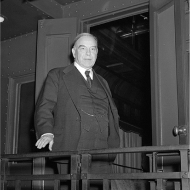 A black and white photo of a man wearing a suit.