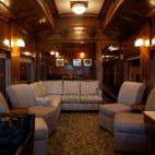 A lounging area with couches in a train car.