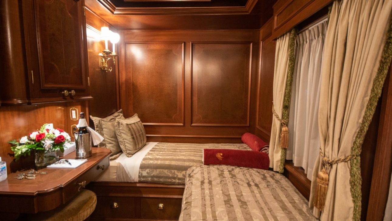 Two twin beds in a train car.