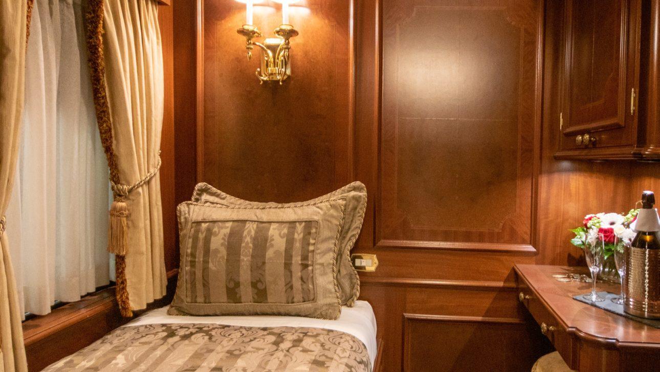 A bed in a train car.