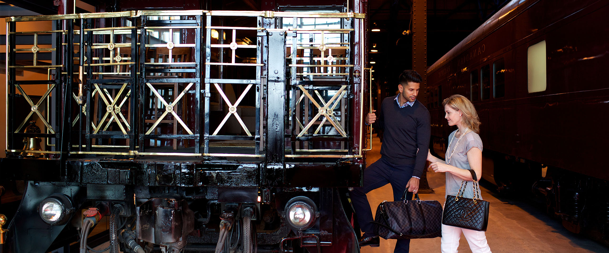 A couple about to board a railcar.