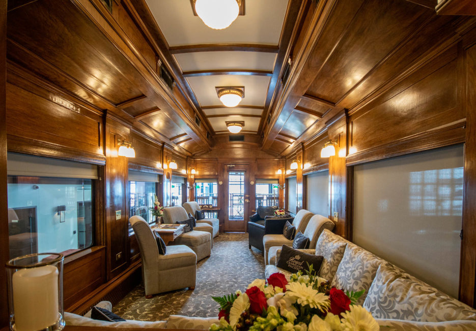 A seating area inside of a railcar.